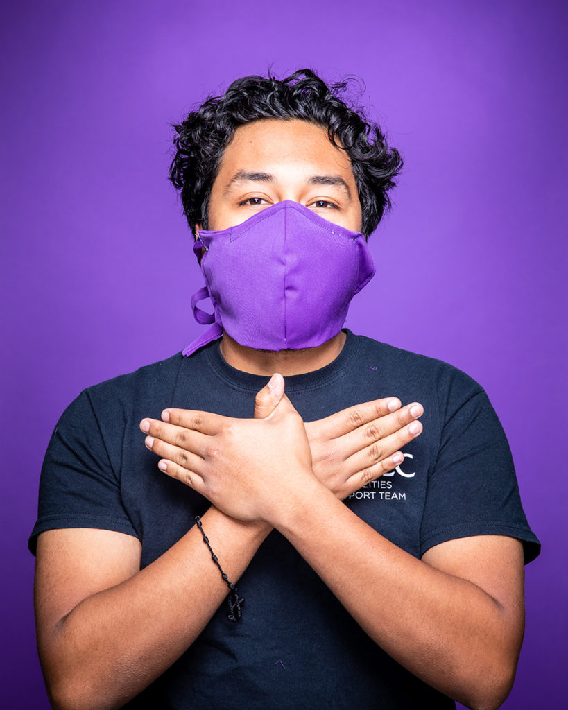 ACC essential employees pose for portraits wearing non medical facial coverings that were cut and sewn by other ACC employees